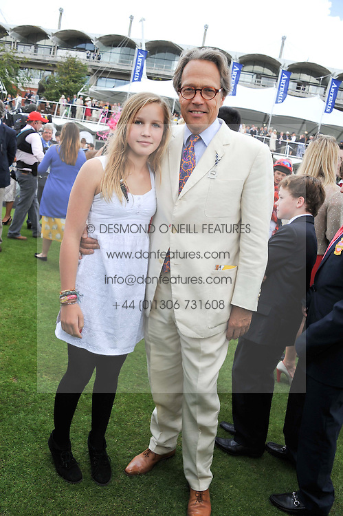 The EARL OF MARCH and his daughter LADY ELOISE GORDON-LENNOX at the 3rd day of the 2012 Glorious Goodwood racing festival at Goodwood Racecourse, West Sussex on 2nd August 2012.