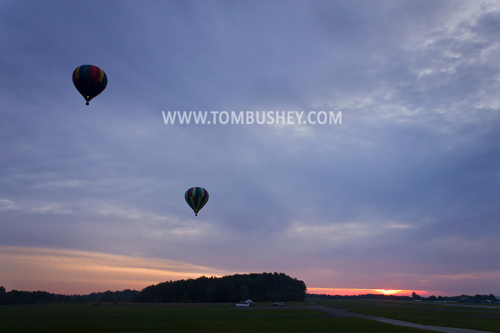 Middletown, New York - Hot air balloons take off from Randall  Airport at dawn on Aug. 18, 2013.