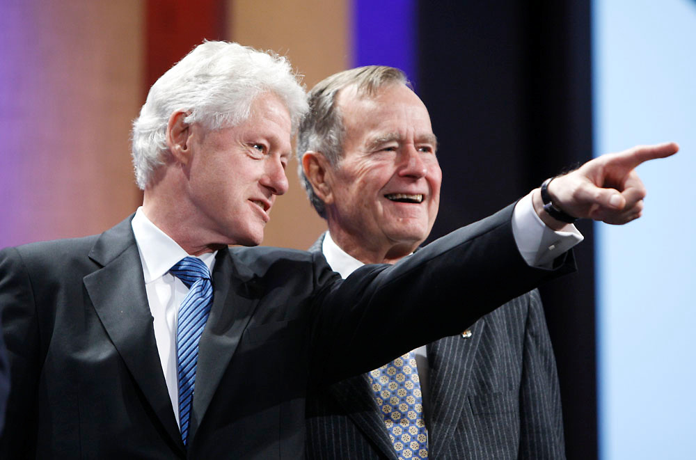 Former presidents Bill J. Clinton and George H. Bush photographed onstage during the Clinton Global Initiative