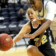 UNCW's Amber Reeves and UNCP's Katelyn Mithchell scramble for a loose ball Sunday November 16, 2014 at Trask Coliseum in Wilmington, N.C. (Jason A. Frizzelle)