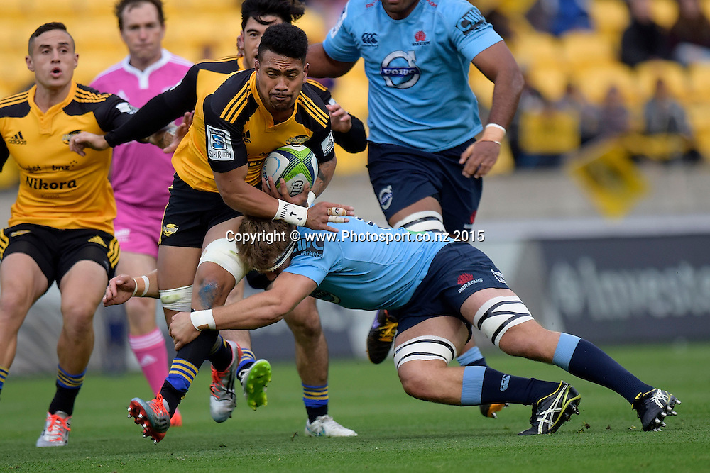 Hurricanes' flank Arsie Savea is tackled by Waratahs' Pat McCutcheon during the Super Rugby - Hurricanes v Waratahs rugby union match at the Westpac Stadium in Wellington on Saturday the 18th of April 2015. Photo by Marty Melville / www.Photosport.co.nz