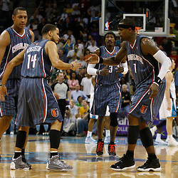 Apr 07, 2010; New Orleans, LA, USA; Charlotte Bobcats guard D.J. Augustin (14) celebrates with teammate guard Stephen Jackson (1) after hitting the go ahead shot during the fourth quarter against the New Orleans Hornets at the New Orleans Arena. The Bobcats defeated the Hornets 104-103. Mandatory Credit: Derick E. Hingle-US PRESSWIRE