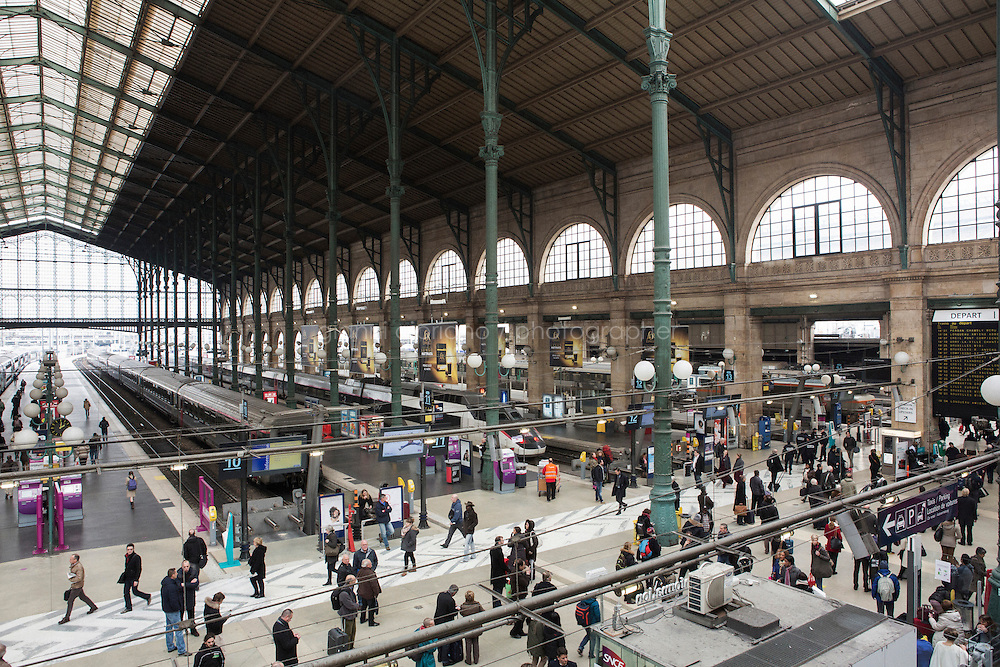 PARIS, FRANCE - 19 NOVEMBER 2014: The Gare du Nord train station, where migrants take trains to Calais, Belgium or the Netherlands in Paris, France, on November 19th 2014.<br /> <br /> After crossing the Italian-French border, migrants take the train to Paris. Some stop in Paris, but the majority continues the journey to Calais (before arriving in London), while others go to countries such Germany, the Netherlands, and Sweden.