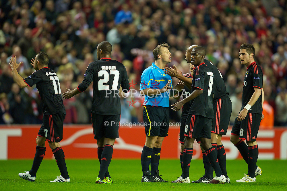 LIVERPOOL, ENGLAND - Thursday, April 8, 2010: Sport Lisboa e Benfica's Luisao argues with referee Bjorn Kuipers after Liverpool's opening goal during the UEFA Europa League Quarter-Final 2nd Leg match at Anfield. (Photo by: David Rawcliffe/Propaganda)
