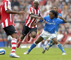 17-09-2006 VOETBAL: PSV - FEYENOORD: EINDHOVEN <br /> PSV verslaat in eigen huis Feyenoord met 2-1 / Serginho Greene en Kone<br /> &copy;2006-WWW.FOTOHOOGENDOORN.NL