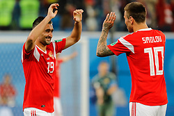 June 19, 2018 - Saint Petersburg, Russia - Alexander Samedov (L) of Russia national team and Fedor Smolov of Russia national team celebrate victory during the 2018 FIFA World Cup Russia group A match between Russia and Egypt on June 19, 2018 at Saint Petersburg Stadium in Saint Petersburg, Russia. (Credit Image: © Mike Kireev/NurPhoto via ZUMA Press)