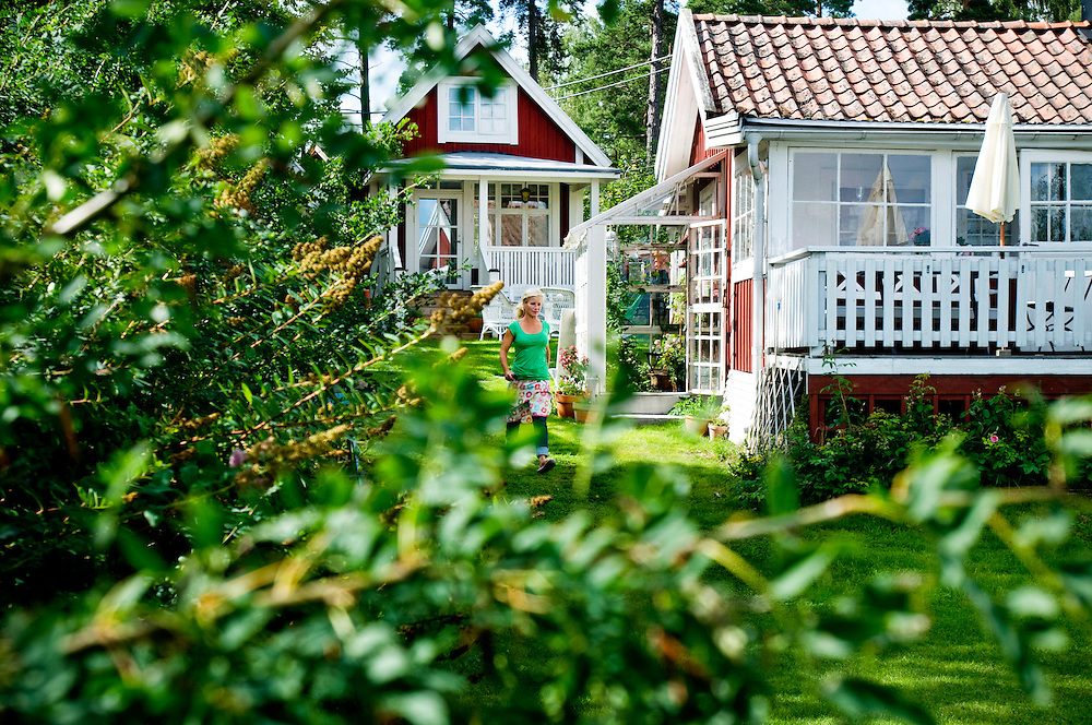 Susanna Zacke in the garden of her summer home on the island Storholmen, outside Stockholm...Photographer: Chris Maluszynski /MOMENT