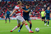 Tyler Smith of Bristol Rovers holds off Tom Anderson Of Doncaster Rovers during the EFL Sky Bet League 1 match between Doncaster Rovers and Bristol Rovers at the Keepmoat Stadium, Doncaster, England on 19 October 2019.