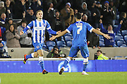 Brighton striker (on loan from Manchester United), James Wilson (21) celebrates with Brighton central midfielder, Beram Kayal (7) after scoring during the Sky Bet Championship match between Brighton and Hove Albion and Charlton Athletic at the American Express Community Stadium, Brighton and Hove, England on 5 December 2015. Photo by Geoff Penn.