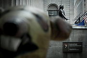 "An inflatable rat, ""The Scabby Rat"" signals a worker dispute between construction workers and the 100 Broadway. In the background the statue of George Washington outside the Federal Hall on Wall Street."