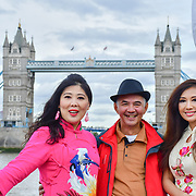 "See Li and Chinese Soprano 王蓓蓓,Wang Beibei (L) and  朱珍,Jane Maria sings 我和我的祖国,Me and my country to celebration of the 70th China National Day 2019 and a Chinese ""Qipao"" flash mob, London, 28 September 2019, UK."