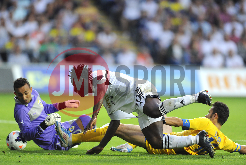 """Swansea City's Wilfried Bony manages to squeeze the ball past Petrolul Ploiesti goalkeeper, Peterson Dos Santos  - Photo mandatory by-line: Joe Meredith/JMP - Tel: Mobile: 07966 386802 22/08/2013 - SPORT - FOOTBALL - Liberty Stadium - Swansea -  Swansea City V Petrolul Ploiesti - Europa League Play-Off EDITORIAL USE ONLY. No use with unauthorised audio, video, data, fixture lists, club/league logos or """"live"""" services. Online in-match use limited to 45 images, no video emulation. No use in betting, games or single club/league/player publications"""