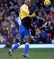 Photo: Alan Crowhurst.<br />Watford v Cardiff City. Coca Cola Championship. 25/02/2006. Watford's Jordan Stewart (R) outjumps Cameron Jerome.