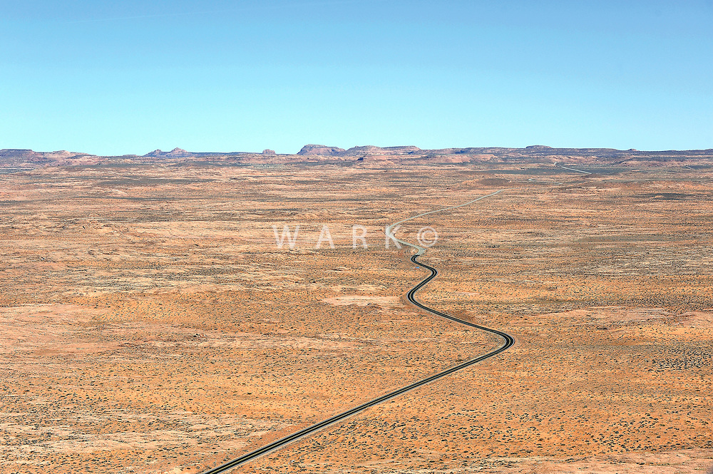 Freshly paved road snakes into old road in lonely desert