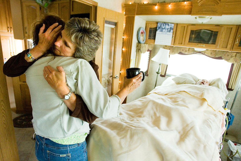 June 13 -- Joni Connelly comforts Nancy Warner as her husband of five days, Dick, lays unconscious. Marriage was a priority for Dick since he realized his body was beginning to give up its fight against cancer.