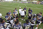 SAN DIEGO - JUNE 10:  General view of a San Diego Chargers coach talking to players during minicamp practice at the San Diego Chargers Park practice field on June 10, 2006 in San Diego, CA. ©Paul Anthony Spinelli
