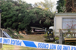 © Licensed to London News Pictures. 28/10/2013<br /> Caravan crushed by tree with the girls bed visable in this pic.<br /> Storm death,  Lydens Lane,Hever.  near  Lydens Barn<br /> A 17 year old girl has been killed when a tree fell on her caravan while she was sleeping. <br /> Storm Damage today (28.10.2013)<br /> Photo credit :Grant Falvey/LNP