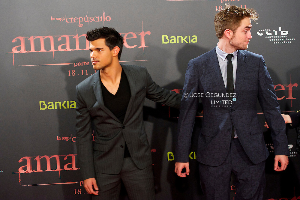 US Actor Taylor Lautner and US Actor Robert Pattinson attend the Spain premiere of The Twilight Saga: Breaking Dawn Part 1 at Forum del Centro de Convenciones Internacional in Barcelona, Spain