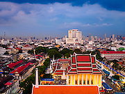 20 NOVEMBER 2015 - BANGKOK, THAILAND: Looking east. The skyline of the city of Bangkok as seen from the top of Wat Saket, also known as the Golden Mount, a historic Buddhist temple in Bangkok.     PHOTO BY JACK KURTZ