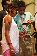 A couple takes a picture of their wedding rings while waiting to participate in the 101 Gay Weddings event put on by Chef Art Smith at the Intercontinental Hotel in Buckhead on Sunday, June 28. (David Welker)