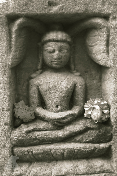 Rock carving detail of a meditating Buddha at Mrigadavam, an ancient temple complex where Gautama Buddha gave his first sermon