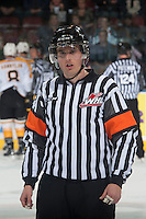 KELOWNA, CANADA - OCTOBER 25: Jeff Ingram, referee, stands on the ice at the Kelowna Rockets as they take on the Brandon Wheat Kings on October 25, 2014 at Prospera Place in Kelowna, British Columbia, Canada.  (Photo by Marissa Baecker/Shoot the Breeze)  *** Local Caption *** Jeff Ingram; referee; official;