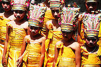 Brightly dressed girls in traditional dress at a ceremony at Puri Agung in Bali, Indonesia.