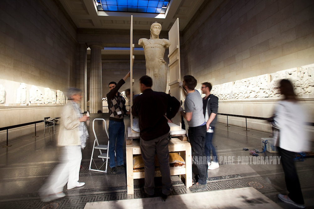 Museum workers prepare the Auriga of Mozia at the British Museum for it's shipment back to California on September 19, 2012, in London, England. (Photo by Warrick Page)
