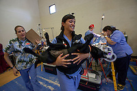 MCDERMITT, NV - AUG 16:  Marissa Francis a 3rd year DMV student at UC Davis carries a dog to a recouping area after surgery during a clinic sponsored by the Humane Society of the United States August 16, 2009 in McDermitt Nevada.  (Photograph by David Paul Morris)