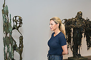 Laurence Edwards launches his sculpture exhibition at Mary Place Gallery, Sydney. A varied selection of bronzed figures-part of the Landscape, Evolution and Exploration. Monon Youdale looking at one of the exhibits.