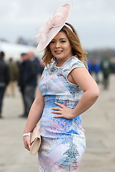 © Licensed to London News Pictures. 08/04/2016. Liverpool, UK. A women wearing a smart dress and hat poses on Ladies Day at the Grand National 2016 at Aintree Racecourse near Liverpool. The race, which was first run in 1839, is the most valuable jump race in Europe. Photo credit : Ian Hinchliffe/LNP