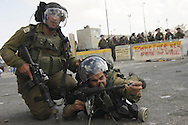 Israeli soldiers in position the Qalandia checkpoint between Ramallah and Jerusalem, during clashes following Friday noon prayers, Sept. 23, 2011.  Photo by Oren Nahshon.