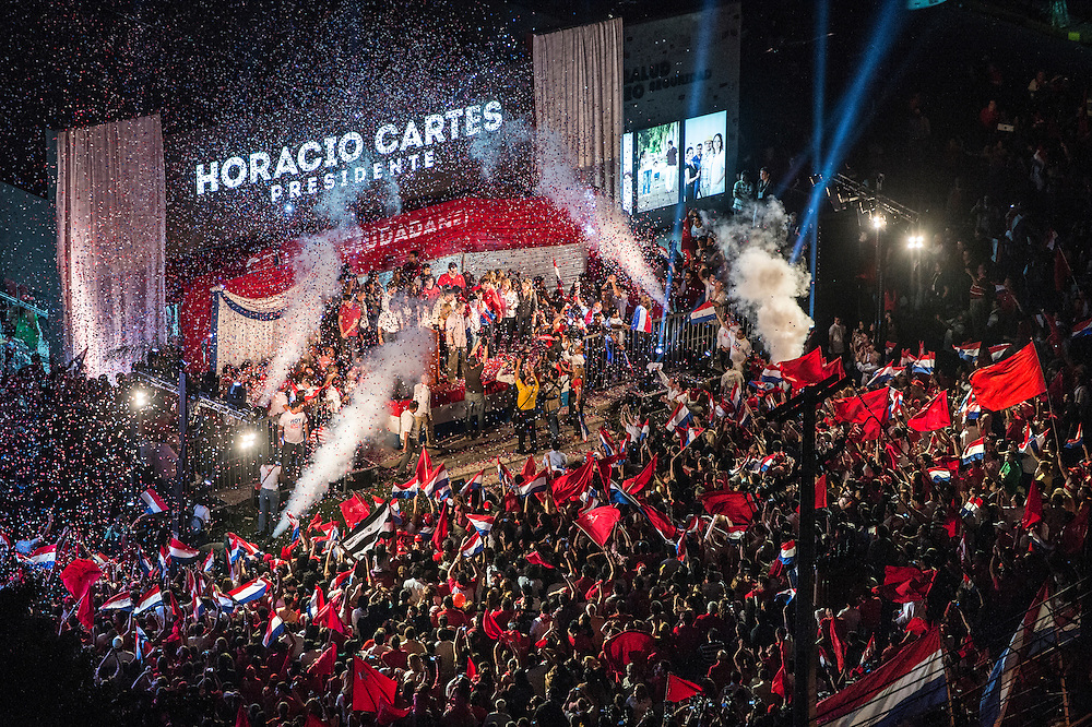 USE ARROWS &larr; &rarr; on your keyboard to navigate this slide-show<br /> <br /> Asuncion, Paraguay, 21 April 2013<br /> Paraguayan elected president Horacio Cartes of the Colorado Party celebrates his victory in the general election. <br /> Photo: Ezequiel Scagnetti