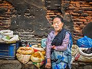 01 AUGUST 2015 - KATHMANDU, NEPAL:  A spice vendor on a sidewalk in Thamel neighborhood of Kathmandu, Nepal.      PHOTO BY JACK KURTZ