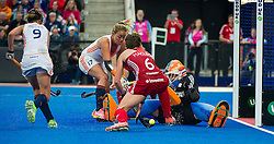 England's Hannah Macleod battles for the ball with Maartje Paumen and Joyce Sombroek of The Netherlands. England v The Netherlands - Final Unibet EuroHockey Championships, Lee Valley Hockey & Tennis Centre, London, UK on 30 August 2015. Photo: Simon Parker