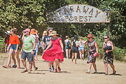 People leaving the Faraway Forest - The 2018 Latitude Festival, Henham Park. Suffolk 14 July 2018