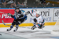 KELOWNA, CANADA - APRIL 12: Tyson Baillie #24 of Kelowna Rockets gets tripped up checking Chaz Reddekopp #29 of Victoria Royals on April 12, 2016 at Prospera Place in Kelowna, British Columbia, Canada.  (Photo by Marissa Baecker/Shoot the Breeze)  *** Local Caption *** Tyson Baillie; Chaz Reddekopp;