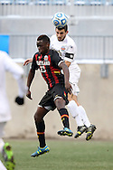 15 December 2013: Notre Dame's Andrew O'Malley (behind) heads the ball over Maryland's Schillo Tshuma (ZIM) (23). The University of Maryland Terripans played the University of Notre Dame Fighting Irish at PPL Park in Chester, Pennsylvania in a 2013 NCAA Division I Men's College Cup championship match. Notre Dame won the game 2-1.