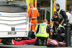 © Licensed to London News Pictures. 1/610/2018. London, UK. Paramedic attend a road traffic accident outside Westminster Abbey where a person had an accident with National Express coach. Photo credit: Dinendra Haria/LNP