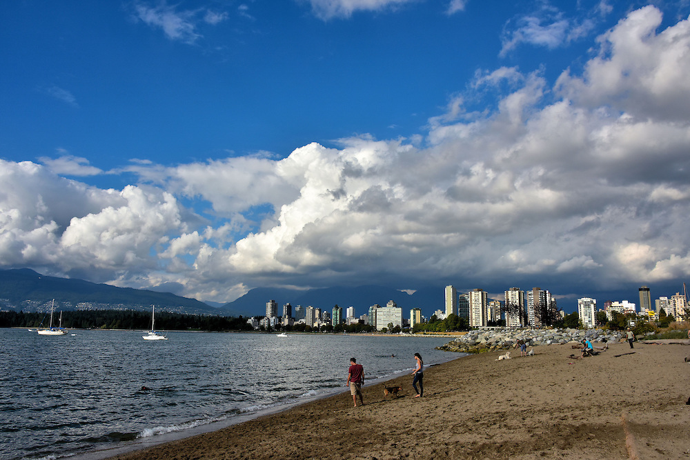 Couple with Dog on Kitsilano Beach in Vancouver, Canada <br />
