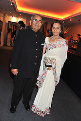 MR & MRS GOPICHAND HINDUJA at the launch of the India Fantastique Exhibition and book launch featuring photographs by Ram Shergill and fashion by India's leading couturiers Abu Jani and Sandeep Khosla held at Sotheby's, 34-35 New Bond Street, London on 5th September 2012.