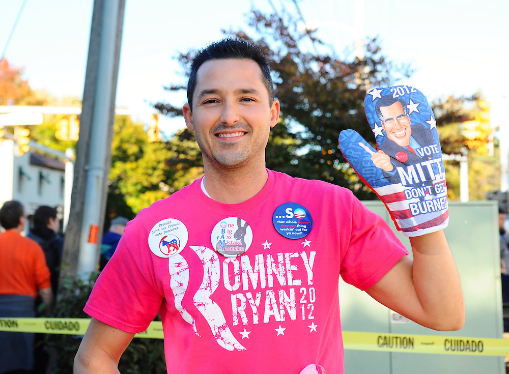 LAURA FONG | DAILY KENT STATER  Vendors hawked Republican paraphenila outside Tuesday's rally for U.S Presidential hopeful Mitt Romney like this oven Mitt that reads 'don't get burned'.
