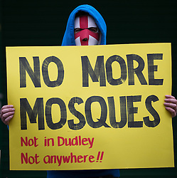 © Licensed to London News Pictures . FILE PICTURE DATED 07/02/2015 of the most recent EDL demonstration in Dudley , UK where approximately 500 EDL supporters protested the building of a new mosque in the town as today (Monday 23rd March 2015) Conservative Party candidate for Dudley North , Afzal Amin , faces pressure to resign following reports he offered to pay EDL supporters to organise a fake demonstration in the town . Photo credit : Joel Goodman/LNP