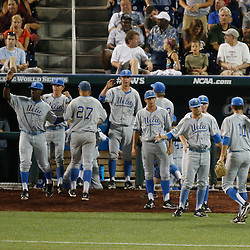 Jun 24, 2013; Omaha, NE, USA; UCLA Bruins celebrate after ending the seventh inning in game 1 of the College World Series finals against the Mississippi State Bulldogs at TD Ameritrade Park. Mandatory Credit: Derick E. Hingle-USA TODAY Sports
