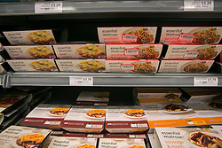 © licensed to London News Pictures. London, UK 13/02/2013. Ready meal products pictured in a Waitrose branch. Frozen packs of 16 beef meatballs from Essentials range removed from sale. Meatballs labelled as being made from beef contained pork. Photo credit: Tolga Akmen/LNP