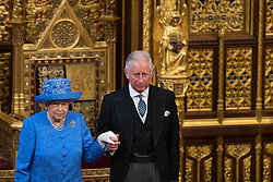 Queen Elizabeth II and the Prince of Wales during the State Opening of Parliament by Queen Elizabeth II, in the House of Lords at the Palace of Westminster in London.