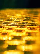 Golden reflection abstract sunlight reflects off broken glass