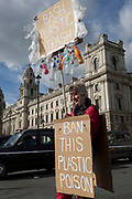 On the occasion of Commonwealth Day, an environmental activist stands outside the Treasury Office in Parliament Square, advocating the ban on plastics around the world, on 11th March 2019, in Westminster, London, England.