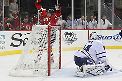 Mar 23; Newark, NJ, USA; New Jersey Devils center Jacob Josefson (16) scores a goal against Toronto Maple Leafs goalie James Reimer (34) during the second period at the Prudential Center.