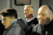Eastleigh manager Ronnie Moore peering through the fans to look at the players warming up before the The FA Cup match between Eastleigh and Swindon Town at Arena Stadium, Eastleigh, United Kingdom on 4 November 2016. Photo by Graham Hunt.